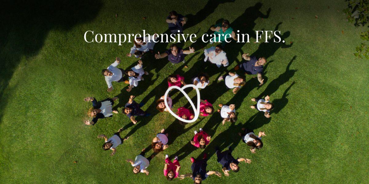Facialteam's comprehensive care team holding Facialteam's logo on a photo taken in the garden of the clinic in Marbella